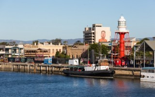 A view of the Wharf and Lighthouse with a Wonderwalls artwork visible from a distance